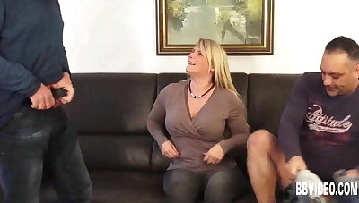 Busty german milf takes two cocks