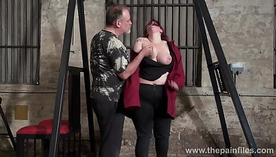 Obese red haired woman Emma gets punished in the BDSM district