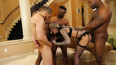 Tattooed sinner Leigh Raven revels here a hardcore interracial gangbang
