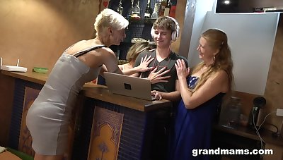 Three sex-crazy mature women fuck handsome lad and make him cum several times